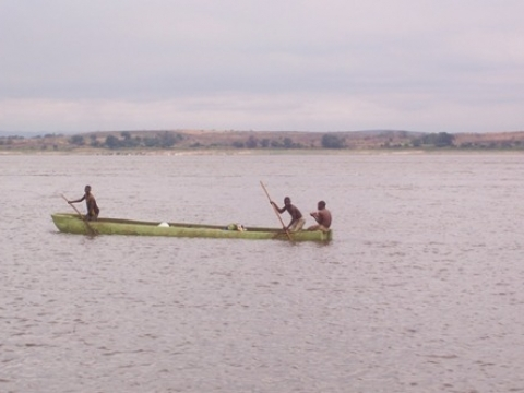 Crossing the Congo River in a pirogue