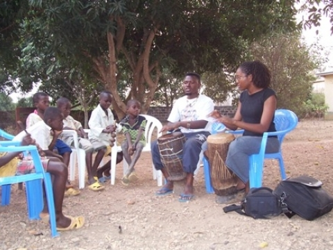 Learning to drum with my research consultant Ne Nkamu